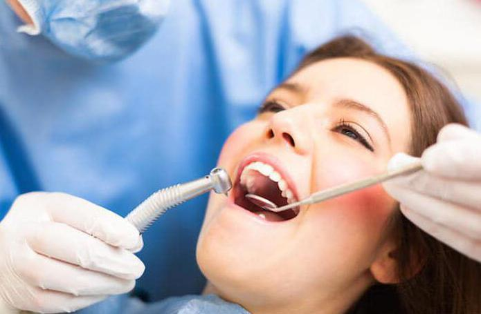 от чего появляется зубной камень