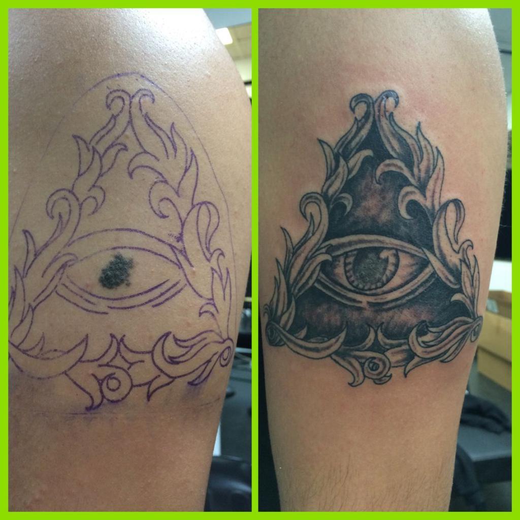 татуировка с родинкой