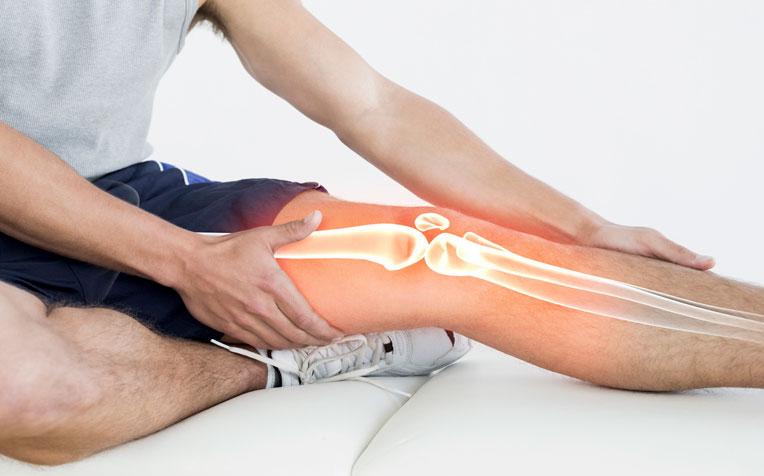 причины боли в колено