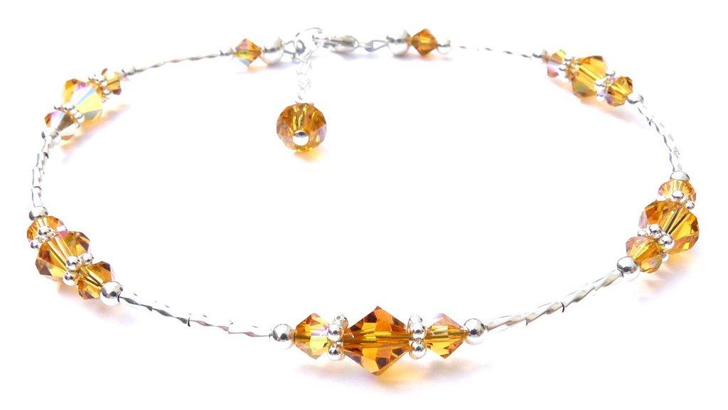 изысканные украшения с золотистыми топазами