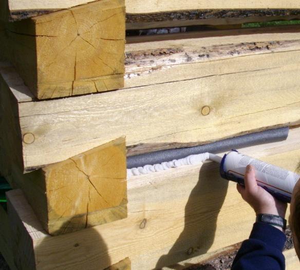 Обработка бревен деревянного дома