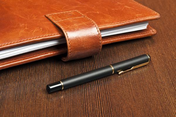 Ручка и ежедневник